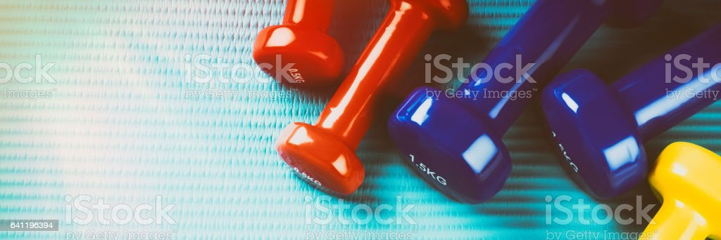 Fitness background with colorful dumbbells. Healthy lifestyle concept stock photo
