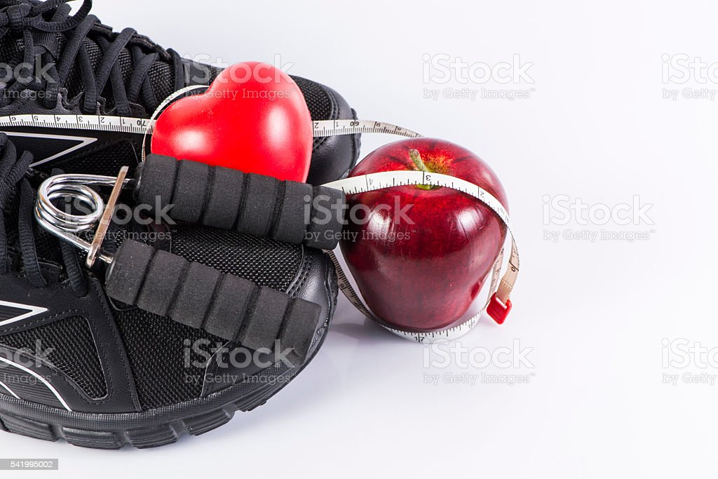 Fitness background with handgrip and apple stock photo