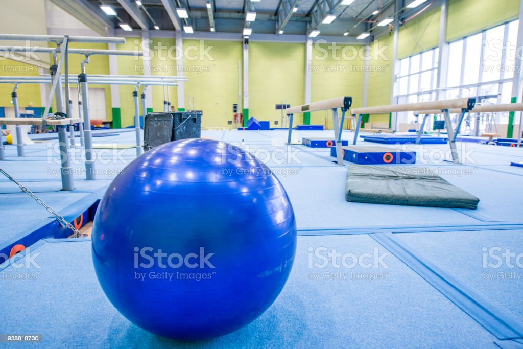 Fitness Ball and Other Gymnastics Equipment in an Empty Gym.