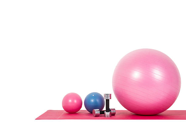 Fitness ball and weights isolated Fitness ball and weights on isolated white background training equipment stock pictures, royalty-free photos & images