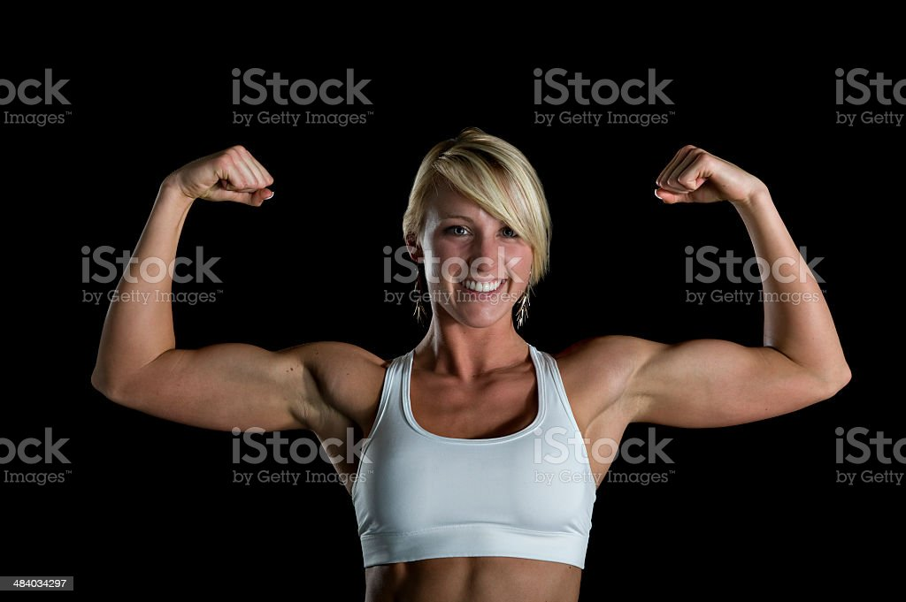 Fitness - Beautiful Fit Woman Flexing Her Biceps (XL) royalty-free stock photo