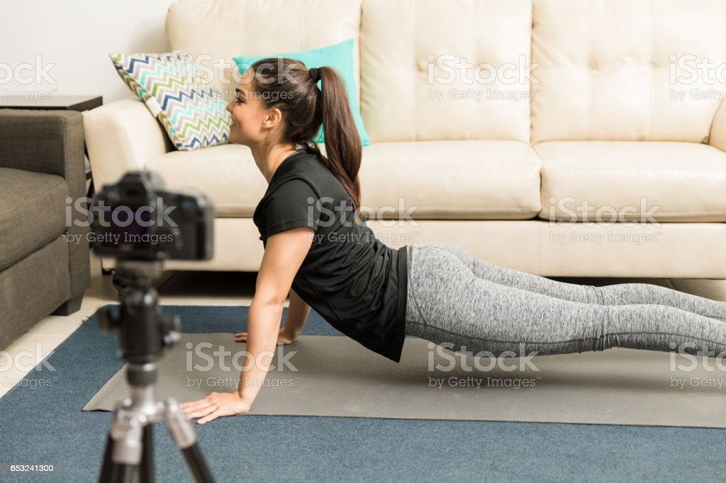Fitness blogger practicing yoga stock photo