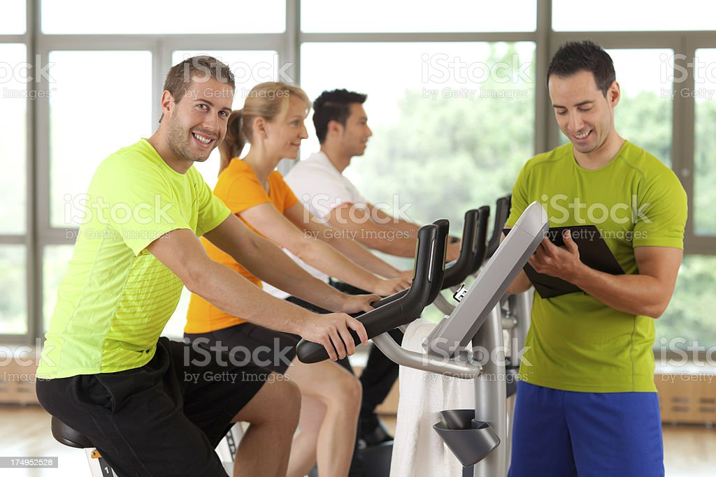 fitness caoch checking people on bikes royalty-free stock photo