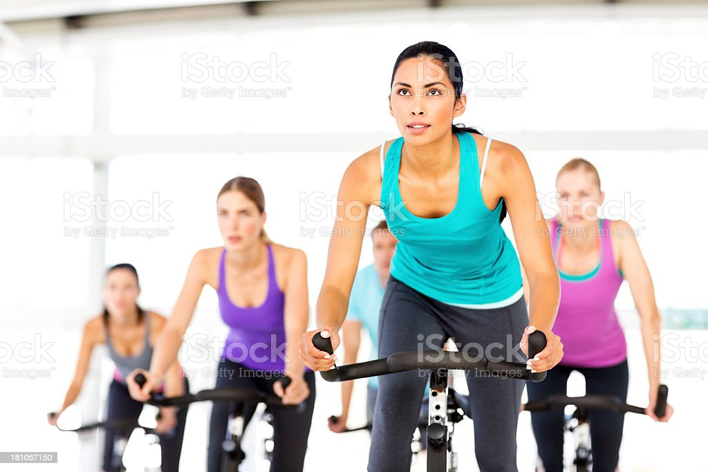 Fitness Class Looking Away While Spinning At Gym stock photo