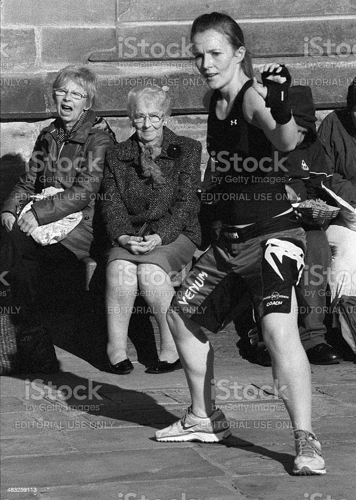 Fitness class taught outdoors in town centre royalty-free stock photo