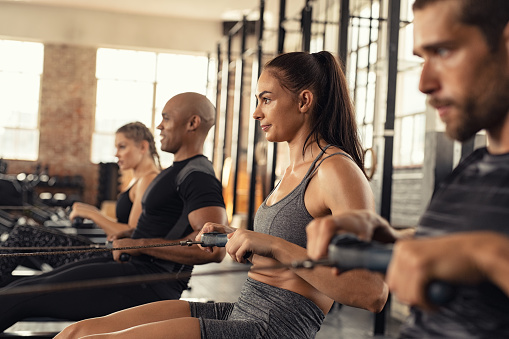 istock Fitness class training on rowing machine 1149242329