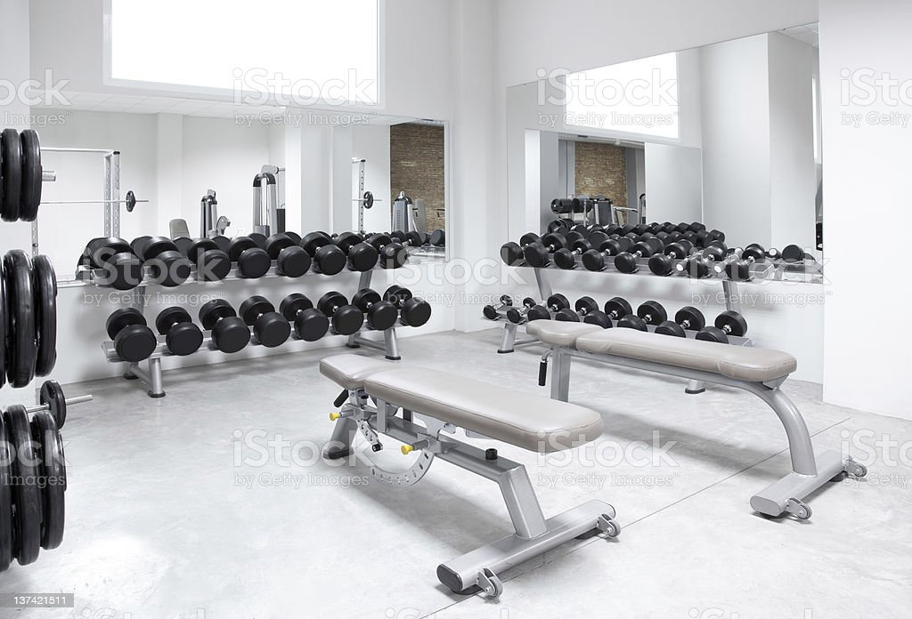 Fitness club weight training equipment gym stock photo