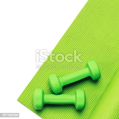 637596492 istock photo Fitness concept - green yoga mat and dumbbells 637596366