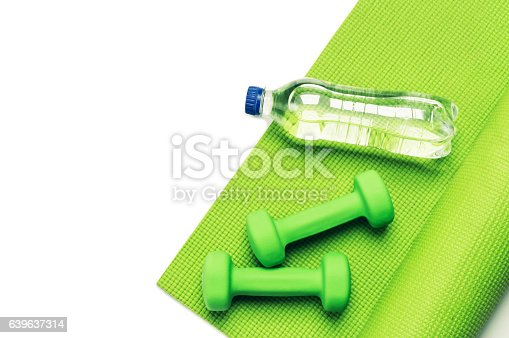 637596492 istock photo Fitness concept - green yoga mat and dumbbells 639637314