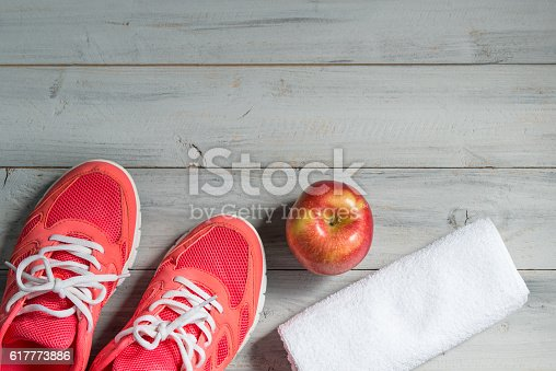 istock Fitness concept, pink sneakers, apple and white towel 617773886