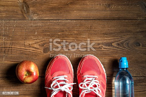 istock Fitness concept, pink sneakers, red apple and bottle of water 622808126