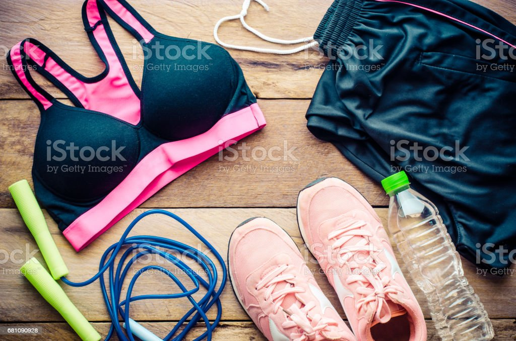 fitness concept with Exercise Equipment on wooden background. royalty-free stock photo