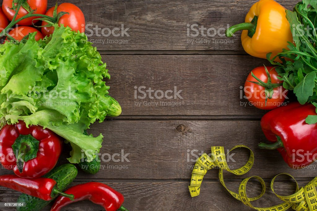 Fitness concept with vegetables. Fitness motivation with centimeter. Fitness motive. Pepper royalty-free stock photo