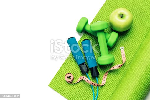 637596492 istock photo Fitness concept - yoga mat, apple, dumbbells and skipping rope 639637422