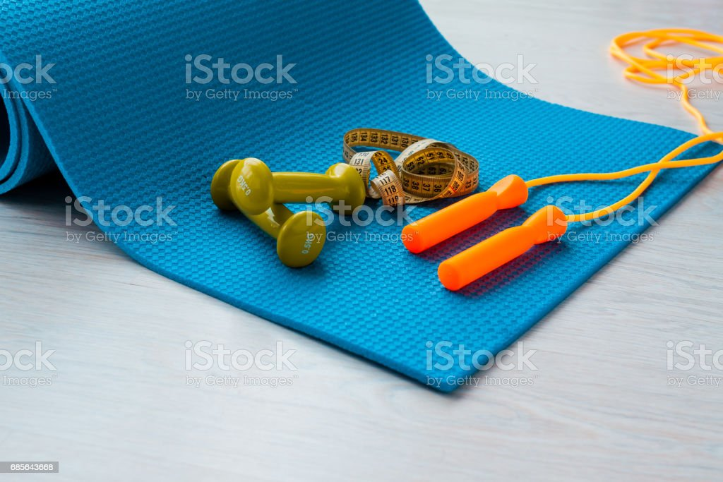 Fitness concept - yoga mat, dumbbells, skipping rope and tape measure royalty-free 스톡 사진