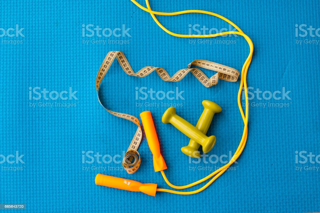 Fitness concept - yoga mat, dumbbells, skipping rope and tape measure 免版稅 stock photo