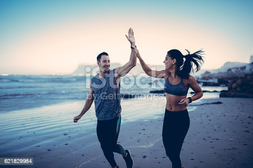 istock Fitness Couple giving each other high five after hard training 621829984