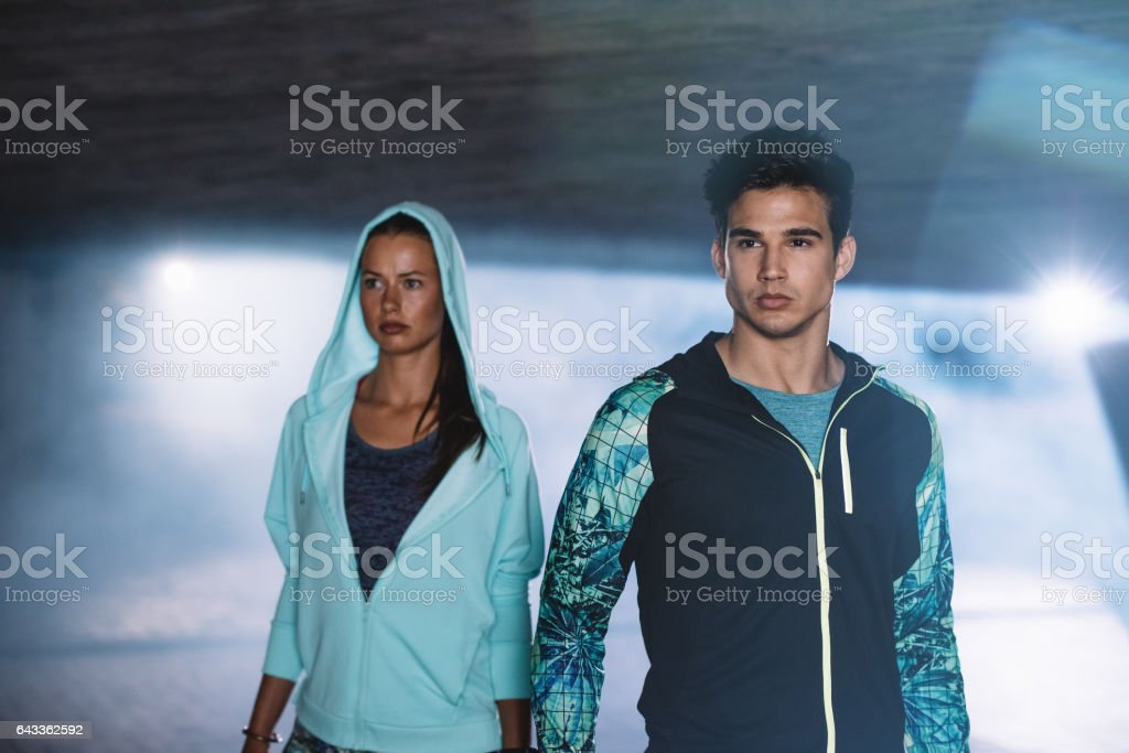 Fitness couple in city at night stock photo