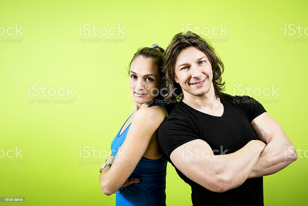 Fitness couple on green background royalty-free stock photo