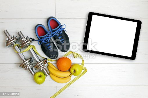 istock fitness equipment and fruits on wooden plank floor 471704320