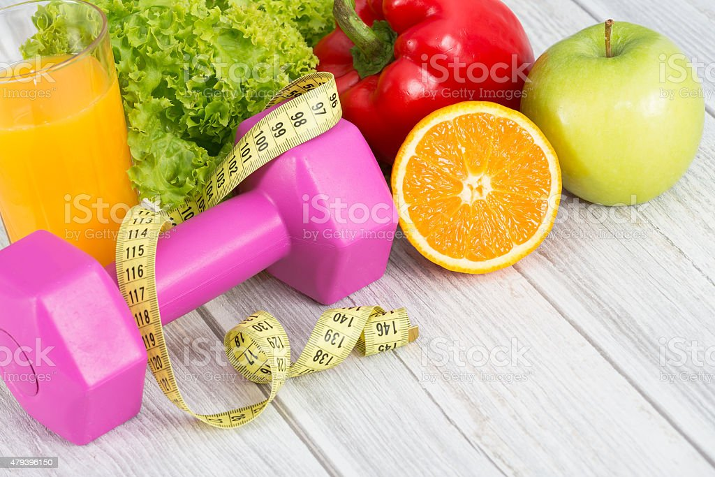 Fitness equipment and healthy food. stock photo