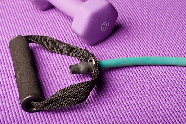Fitness equipment on mat stock photo