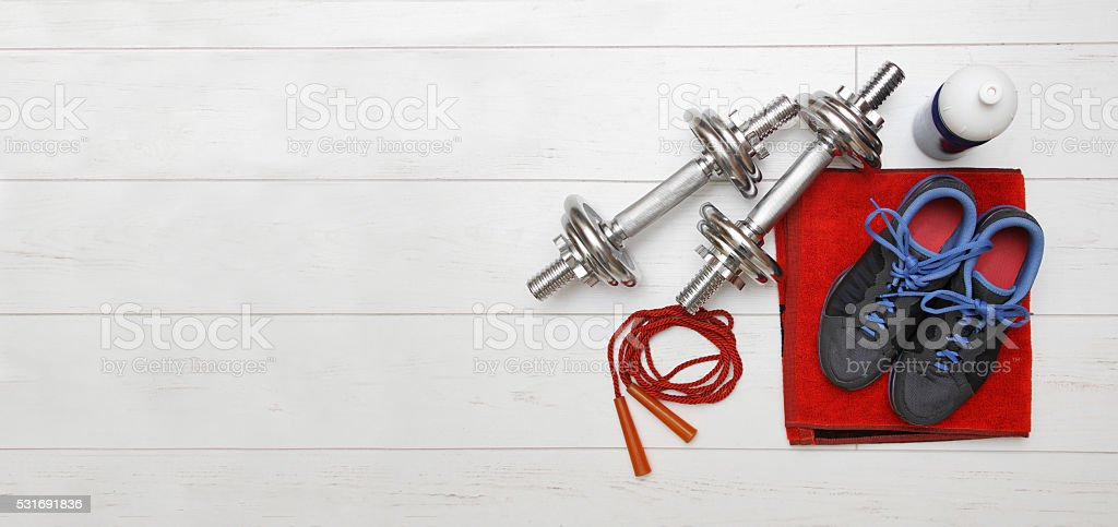 fitness equipment on white wooden plank floor stock photo