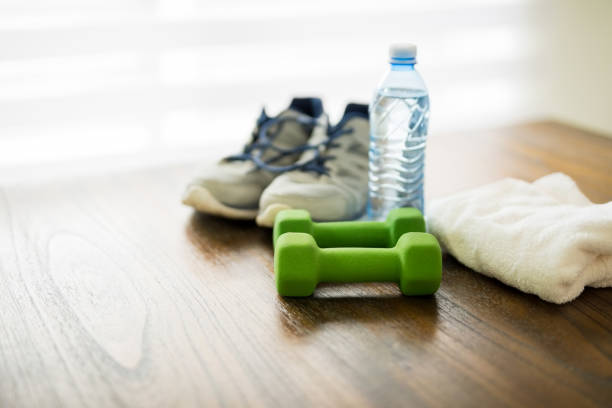 fitness equipment on wooden table - exercise equipment stock photos and pictures