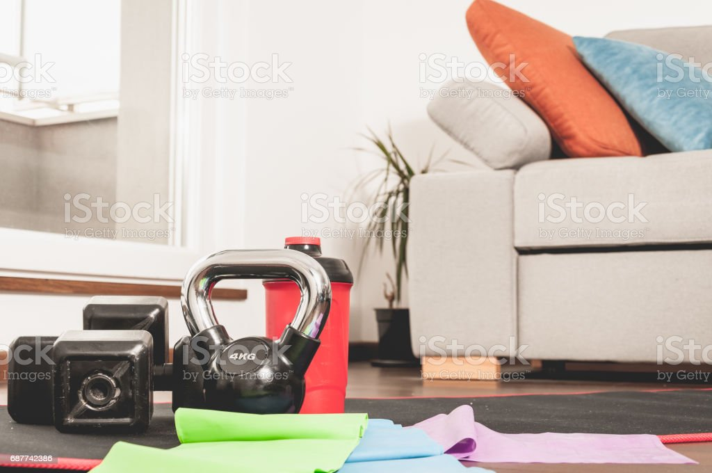 Fitness exercise equipment on the floor. Woman fitness equipment. Home apartment. In home workout training. stock photo