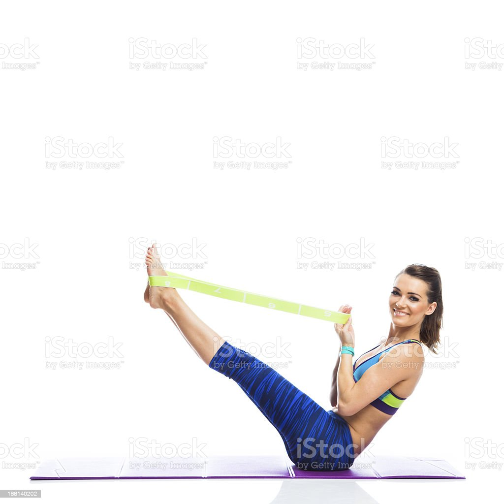 Fitness exercising with resistance band stock photo
