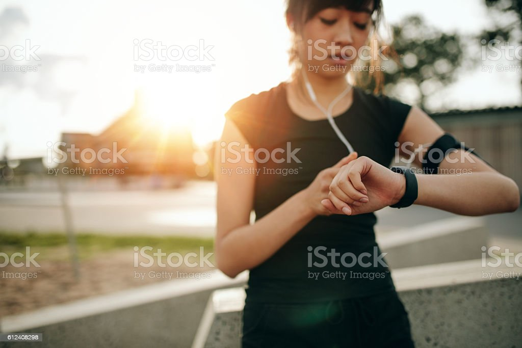 Fitness female checking her performance on smartwatch stock photo