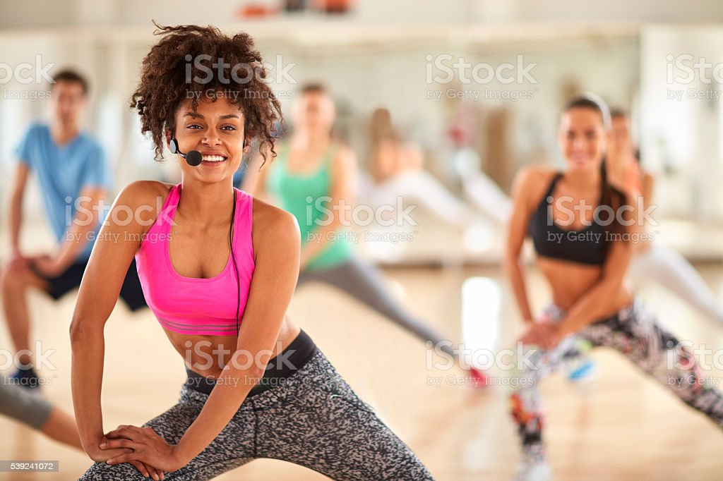 Fitness female trainer in gym royalty-free stock photo