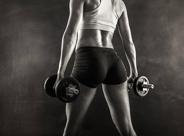 Fitness female  with dumbbells stock photo