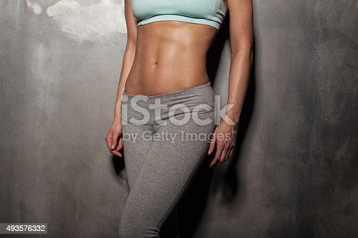 istock Fitness female woman with muscular body, do her workout 493576332