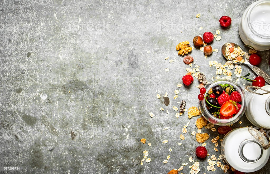 Fitness food. Muesli with berries, nuts and milk in bottles. royalty-free stock photo