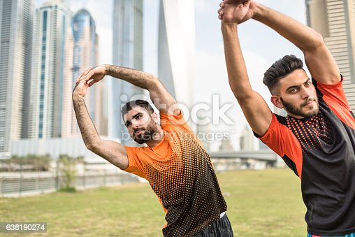 istock fitness friends doing stretching in dubai marina 638190274