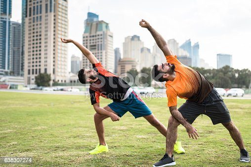 istock fitness friends doing stretching in dubai marina 638307274
