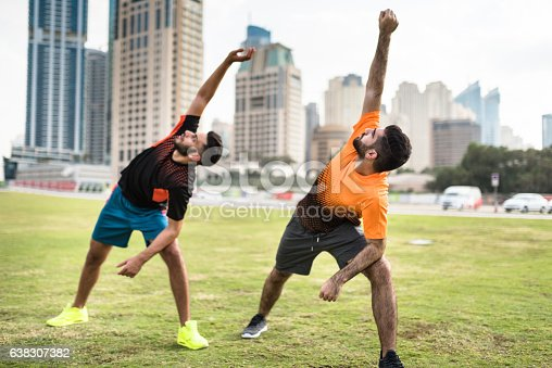 istock fitness friends doing stretching in dubai marina 638307382