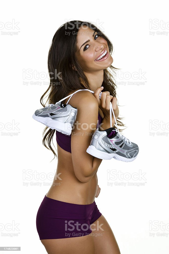 Fitness girl carrying sneakers royalty-free stock photo
