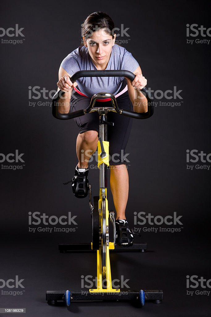 Fitness Girl Exercising on Spin Cycle stock photo