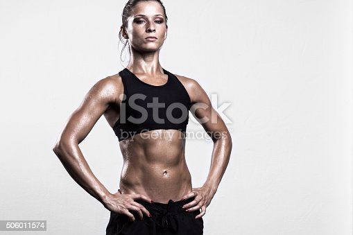 607622628istockphoto Fitness girl posing after workout 506011574