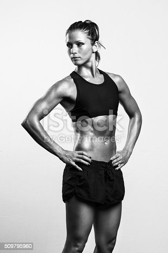 509796496istockphoto Fitness girl posing after workout 509795960