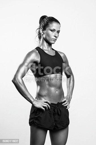 509796496istockphoto Fitness girl posing in studio 506011602