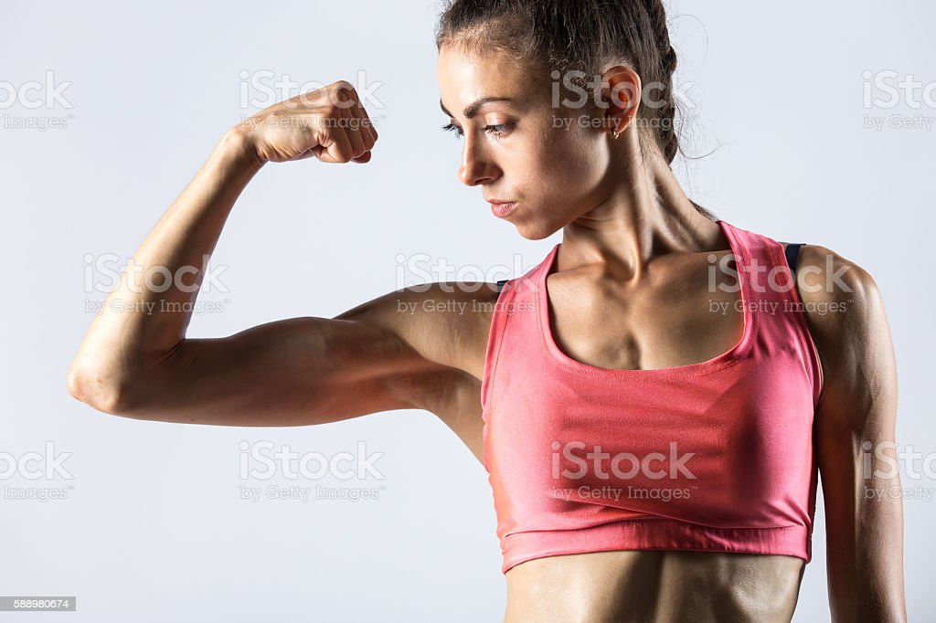 Fitness Girl Showing Biceps Muscles Stock Photo More Pictures Of