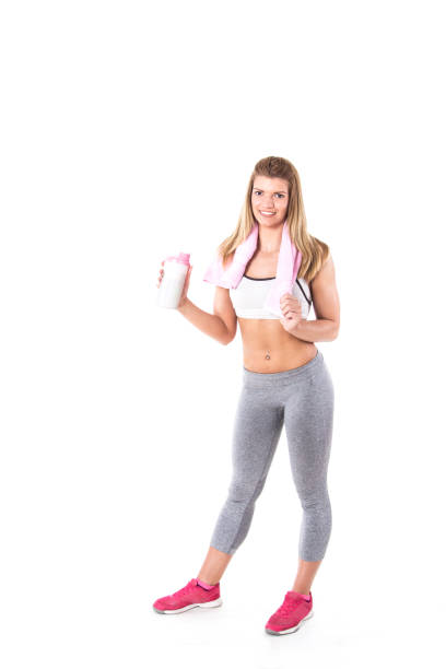 Fitness girl with towel and bottle stock photo