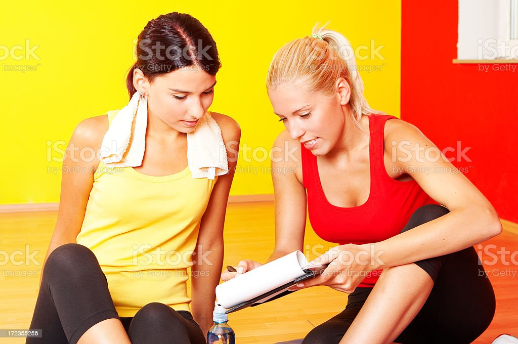 Fitness Girls Consultations royalty-free stock photo