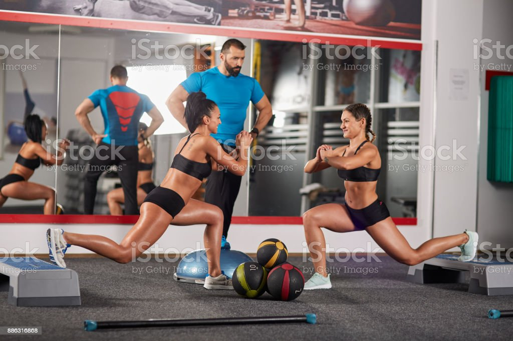 Fitness girls doing lunges stock photo