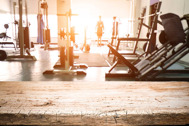 Fitness gym and empty wooden table space. – Foto