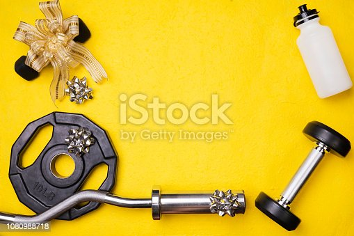 istock Fitness Gym background with equipment ribbon new year concept festive 1080988718