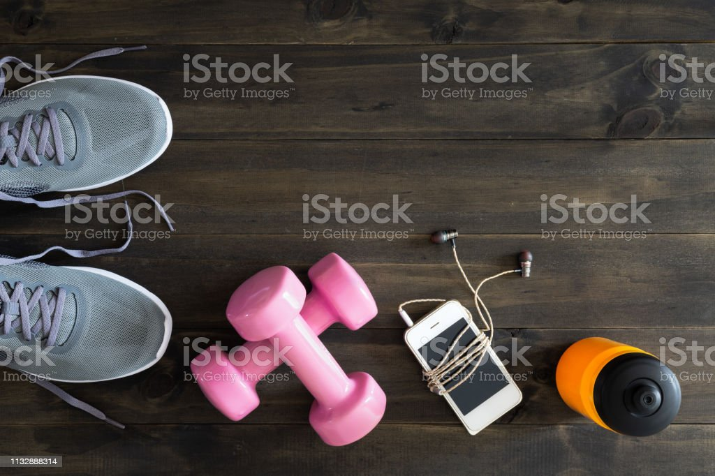 Fitness, healthy and active lifestyles Concept, dumbbells, running...